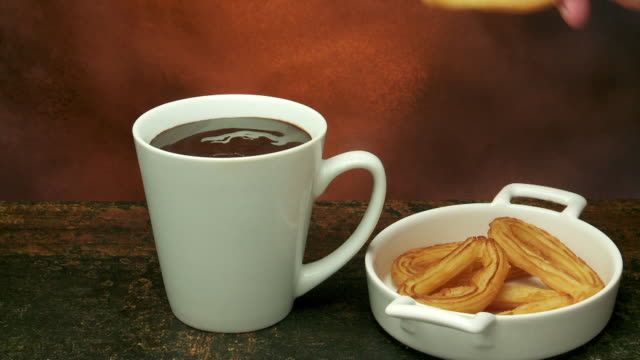 churros dipped in hot chocolate - hot chocolate stock videos and b-roll footage
