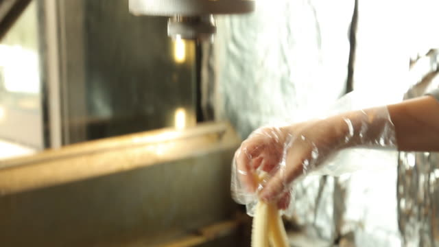 churros dough from the manufacture machinery - churro stock videos & royalty-free footage