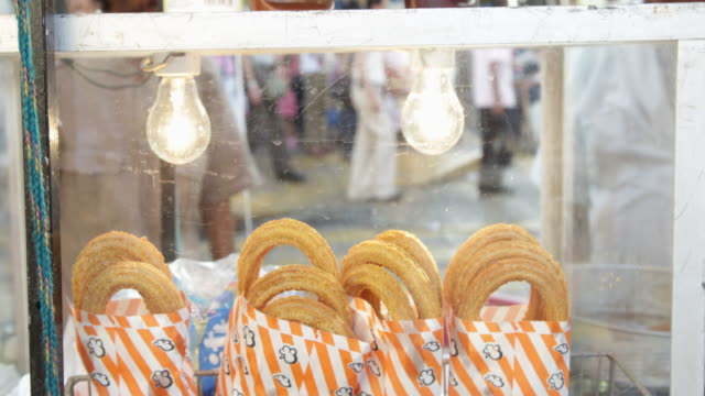 cu of churros on a food cart in merida, mexico. - churro stock videos & royalty-free footage