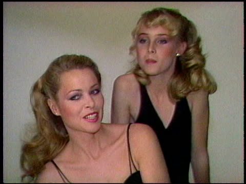 chynna phillips and mother michelle phillips pose for photographer in studio chynna phillips and mother michelle phillips on january 01 1981 in los... - 1981 stock-videos und b-roll-filmmaterial