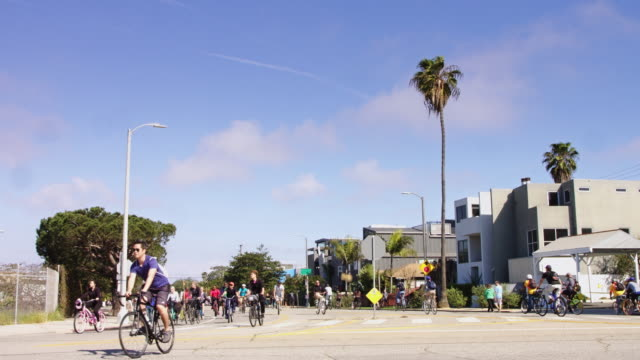 ciclavia march 2017 - cyclists in venice, ca - neighborhood street sign stock videos and b-roll footage