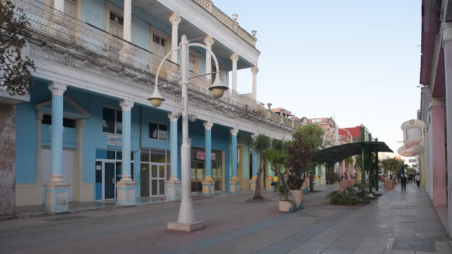 ciego de avila, cuba-march 11-2020: morning view of the city boulevard or pedestrian promenade. a colonial-style building is painted in blue pastel... - local landmark stock videos & royalty-free footage