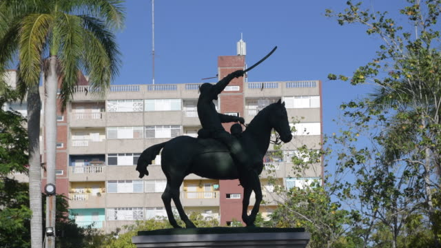 ciego de avila, cuba-march 11-2020: silhouette of a maximo gomez statue in the small parquette of the same name. he was an independentist leader... - local landmark stock videos & royalty-free footage