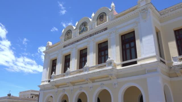cienfuegos, cuba: historic centre surrounding the jose marti park in the cuban city - theatre building stock videos & royalty-free footage