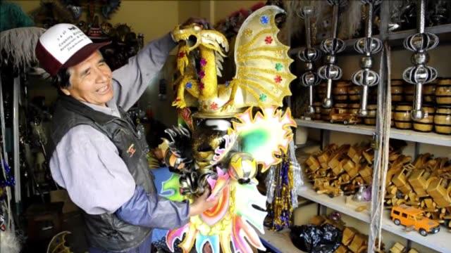 cientos de miles de bolivianos preparan sus trajes para la popular fiesta del gran poder el sabado en la que empresarios indigenas invierten millones... - prosperity stock videos & royalty-free footage
