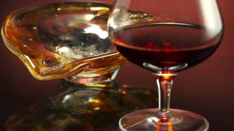 ms r/f cigar smoke blowing over burning cigar placed in ash tray and wine in brandy snifter glass / los angeles, california, united states - ポートワイン点の映像素材/bロール