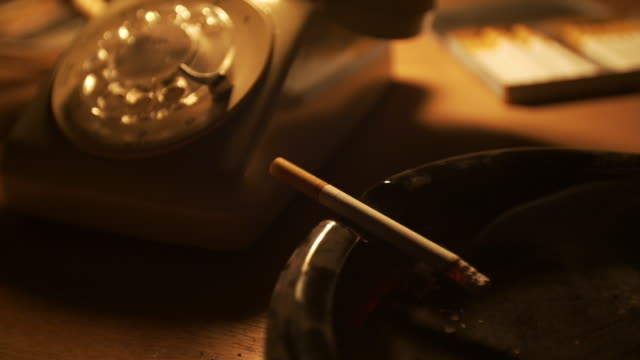 CU of cigarette burning in ashtray