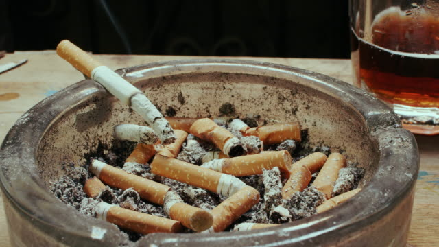 cigarette burning time lapse in ashtray - smoking issues stock videos & royalty-free footage