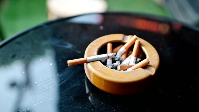 cigarette burning with smoking on ceramic ashtray - tobacco crop stock videos & royalty-free footage