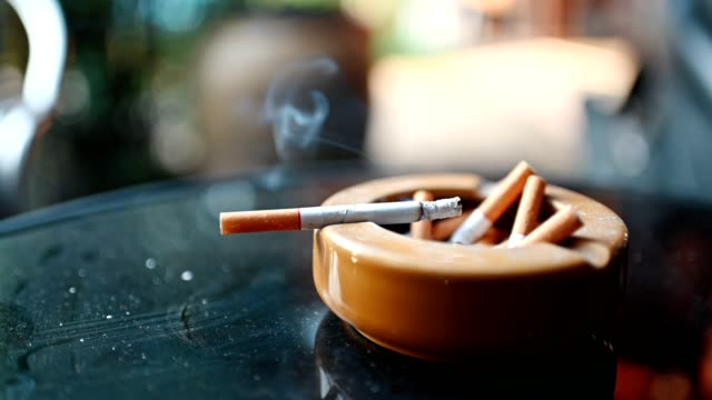 cigarette burning with smoking on ceramic ashtray - smoking issues stock videos & royalty-free footage