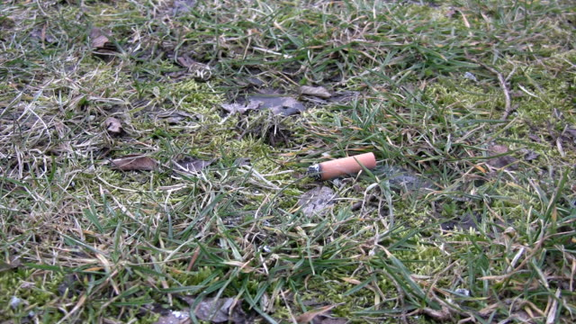 cigarette butt - cigarette stock videos & royalty-free footage