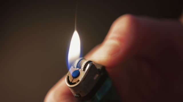 cigarette lighter flickering & being lit - tobacco product stock videos and b-roll footage