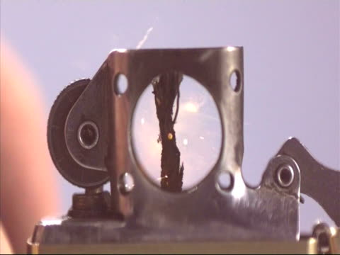 bcu cigarette lighter sparking, high speed - feuerzeug stock-videos und b-roll-filmmaterial