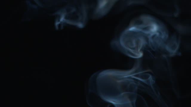 slo mo cu cigarette smoke against black background, new york state, usa - 煙点の映像素材/bロール