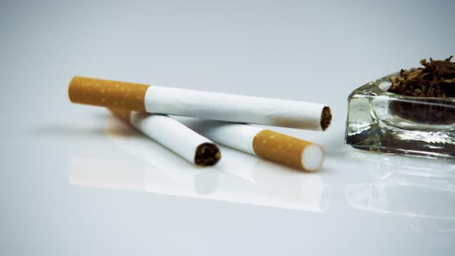 vídeos y material grabado en eventos de stock de cigarettes and tobacco. - cuatro objetos