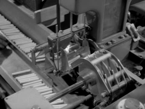 cigarettes move along a production line at a cigarette factory. - cigarette stock videos & royalty-free footage