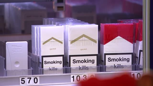 vídeos y material grabado en eventos de stock de cigarettes on display and smokers england london int gv's newsagents selling tobacco / cigarettes on display including sterling benson hedges silk... - vender
