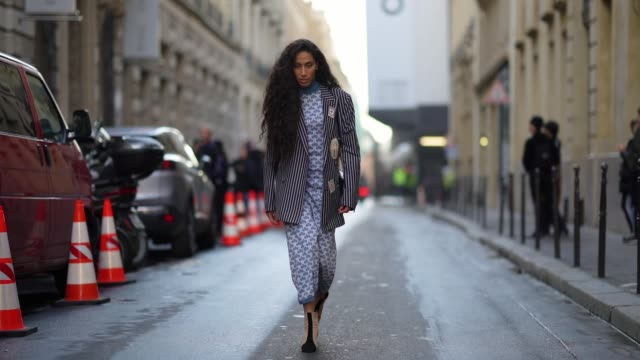 stockvideo's en b-roll-footage met ciinderella b wears earrings a hineck blue and white fishscale patterned dress a navyblue oversized jacket with white stripes suede heeled booties a... - oorbel