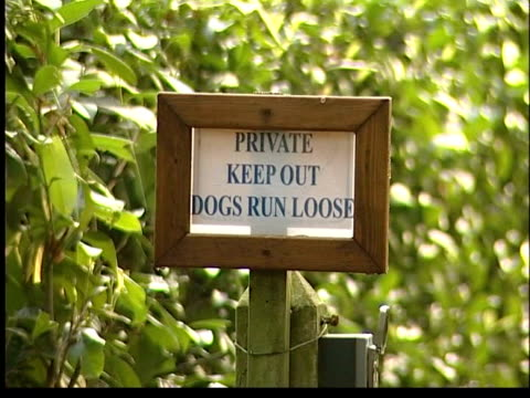 Cilla Black burgled ITN Denham GV Gates to Cilla Black's house Sign on fence of Cilla Black's house saying 'Private Keep Out Dogs Run Loose' MS...
