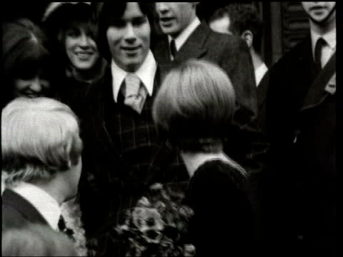 Cilla Black burgled LIB 1969 1960s B/W footage CMS Cilla Black and Bobby Willis after their wedding surrounded by crowd PULL MS Convertible car...
