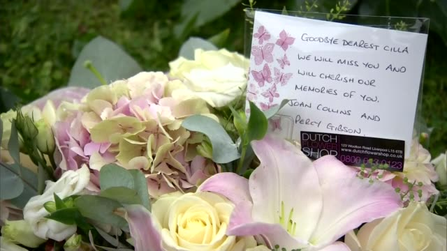 stockvideo's en b-roll-footage met cilla black funeral st mary's church paul o'grady arriving with partner andre portasio gerry marsden arrivals flowers with card from joan collins... - paul o'grady