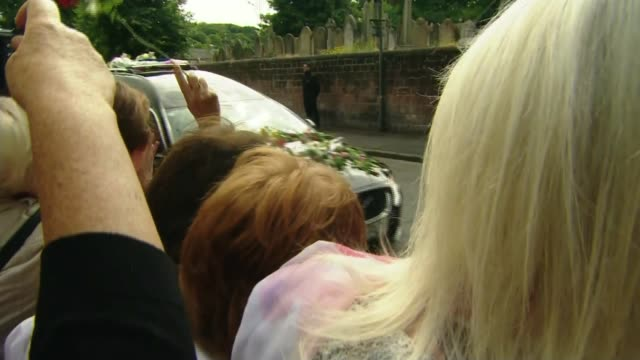cilla black funeral various of hearse containing the body of cilla black along street as crowd applauds and throw flowers comedian and tv presenter... - andrew lloyd webber stock videos & royalty-free footage
