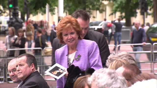 cilla black obe, singer, & bernie ecclestone, formula one, attend the michael winner memorial service. cilla black & bernie ecclestone on june 23,... - bernie ecclestone stock videos & royalty-free footage