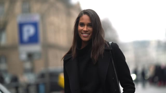 stockvideo's en b-roll-footage met cindy bruna wears a black coat white pants a black turtleneck outside balmain during paris fashion week womenswear fall/winter 2018/2019 on march 2... - coltrui