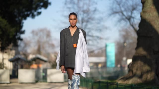 cindy bruna wears a white long scarf, a gray blazer jacket/dress, blue and white denim long boots, a fendi orange mini bag, outside elie saab, during... - gray jacket stock videos & royalty-free footage