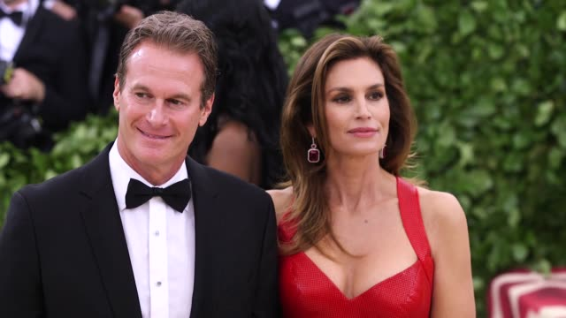 cindy crawford and rande gerber at heavenly bodies: fashion & the catholic imagination costume institute gala at the metropolitan museum of art on... - cindy crawford stock videos & royalty-free footage
