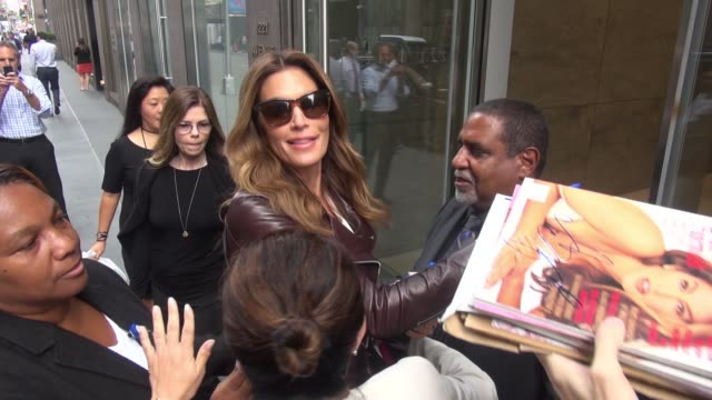 Cindy Crawford leaving SiriusXM Satellite Radio signs for fans in New York City on September 28 2015 in New York City
