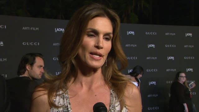 cindy crawford on what they loves about lacma, why it's important to celebrate and support art and film in at 2014 lacma art+film gala honoring... - cindy crawford stock videos & royalty-free footage