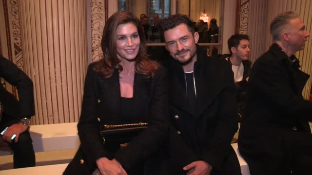 cindy crawford, orlando bloom, sasha luss, juliette binoche, carine roitfeld, giambattista valli, miguel and more front row ofthe balmain menswear... - cindy crawford stock videos & royalty-free footage