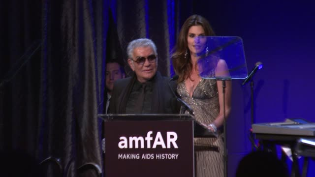 cindy crawford presents roberto cavalli with his award at amfar new york gala to kick off fall 2012 fashion week on in new york - cindy crawford stock videos & royalty-free footage