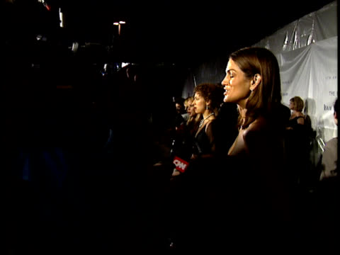 Cindy Crawford speaks to reporters on the red carpet