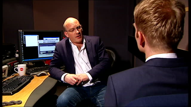 implications of switch from film reels to digital systems richard fish talking to reporter and interview sot talks of benefits of digital... - visual aid stock videos & royalty-free footage