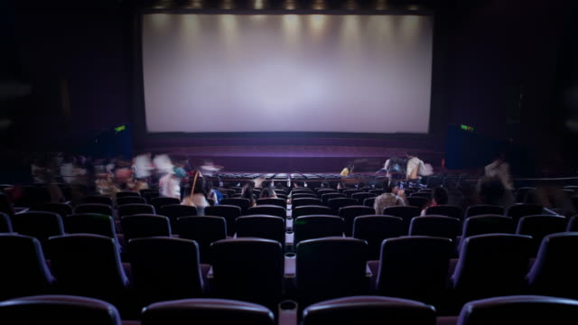 WS T/L Cinema-goer filling movie theatre / Hong Kong
