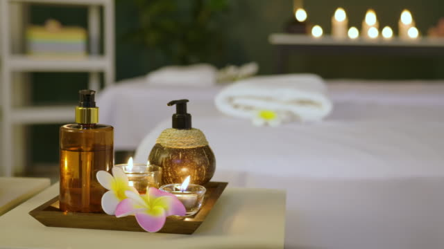 cinemagraph - burning candles in water. composition of spa. - candlelight点の映像素材/bロール