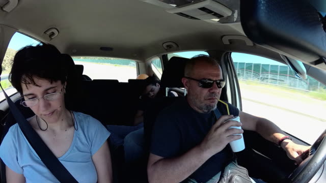 cinemagraph family in car - digital camcorder stock videos & royalty-free footage