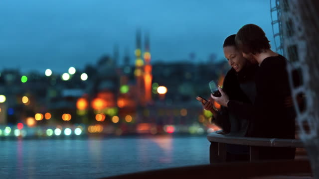 4k- cinemagraph istanbul romantic couple river view parallax - mosque stock videos & royalty-free footage
