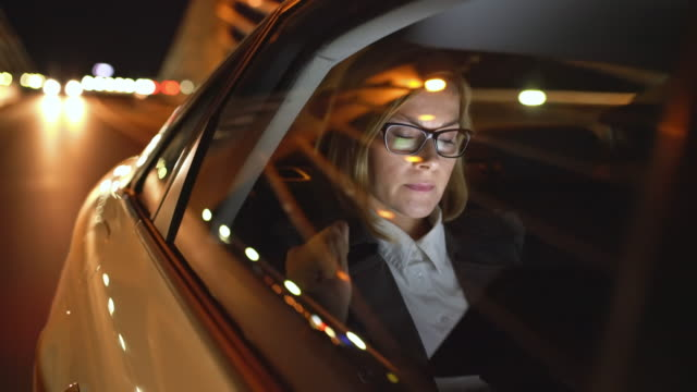 WS Cinemagraph of a businesswoman using a tablet in a taxi