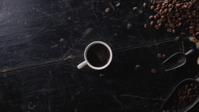 cinemagraph of a cup of fresh hot coffee - coffee break stock videos & royalty-free footage