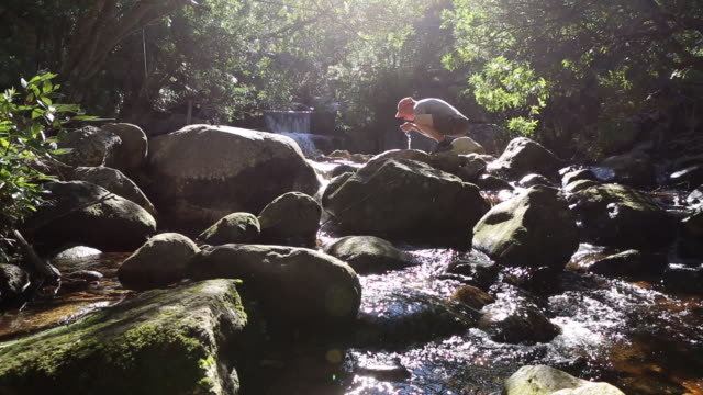 Cinemagraph of a man drinking some river water