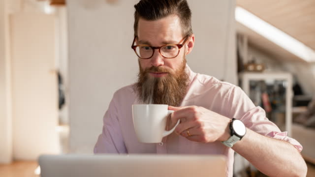 cinemagraph of a man working from home - human body part stock videos & royalty-free footage