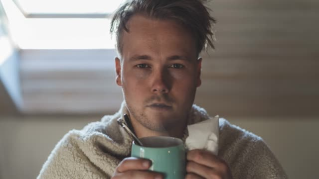 cinemagraph of a young man with a cold at home - illness stock videos & royalty-free footage