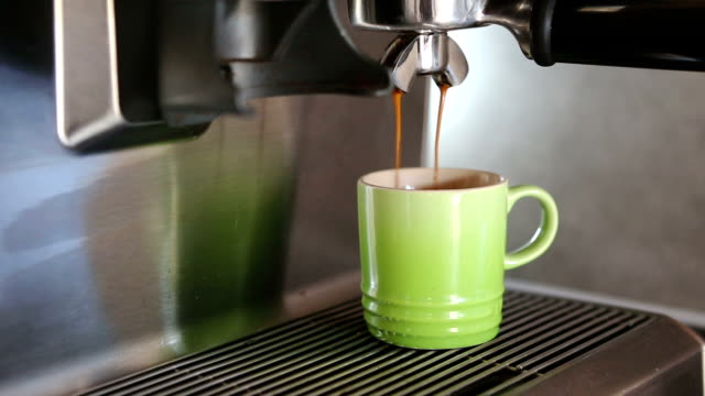 cinemagraph of coffee pouring in a cup - loopable moving image stock videos & royalty-free footage