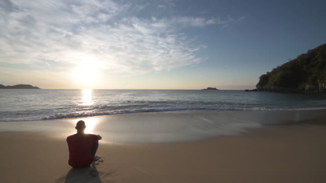 Cinemagraph of man relaxing on empty beach