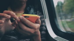 Cinemagraph of Man using smart phone and digital tablet inside the train