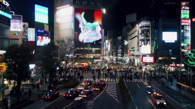 cinemagraph of pedestrians crossing street at shibuya intersection - shibuya station stock videos and b-roll footage