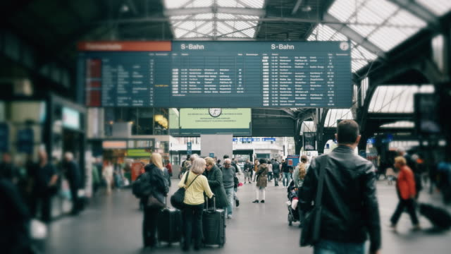 cinemagraph of people commuting  at train station in switzerland - stazione della metropolitana video stock e b–roll
